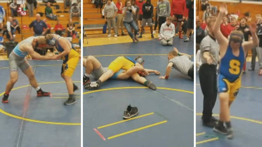 Raw video: High school athlete who lost chance at reaching Nebraska state tournament offers to wrestle rival team's manager in sporting act of kindness caught on camera.