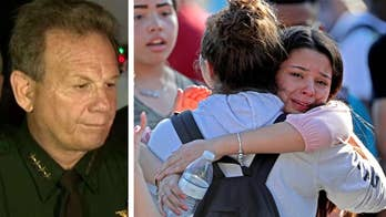 Broward County Sheriff Scott Israel updates media on shooting at Marjory Stoneman Douglas High School, says suspect was armed with an AR-15.