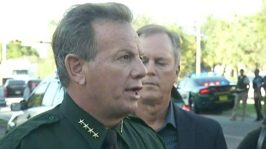 Officials hold press conference after shooting at Marjory Stoneman Douglas High School.