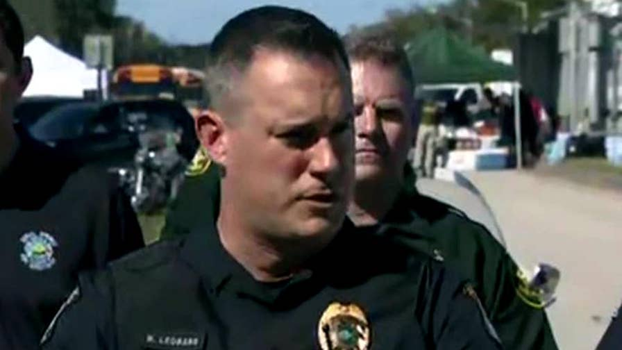 Coconut Creek Police Officer Michael Leonard describes seeing Florida school shooting suspect walking on the sidewalk.