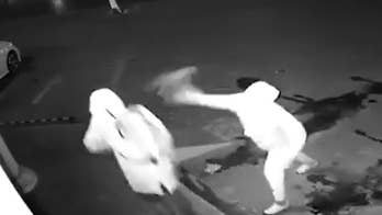 A duo of suspected would-be thieves try to break a window in a burglary attempt, but in the process may have broken something else. Watch as one of the men accidentally throws a brick at his partner's head and had to drag him away.
