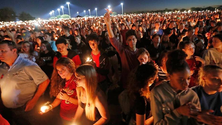 Parkland, Florida community holds a candle light vigil