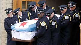 "Chicagoans mourned the death of a ""model police officer"" at his funeral Saturday after he was fatally shot while on duty earlier this week."
