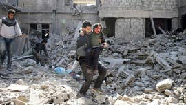 Despite a drop in intensity, shelling and bombardment in the Syrian capital and its embattled eastern suburbs killed at least six people Sunday following the U.N. Security Council's unanimous approval of a resolution demanding a 30-day cease-fire across Syria, opposition activists and residents of Damascus said.