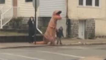Raw video: Officer in Philadelphia suburb witnesses T-Rex walking student to school after getting dispatched for unusual report.
