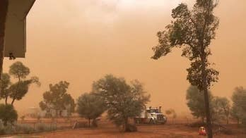 A huge dust storm, complete with 60 mph winds hits Charleville in Queensland, Australia and deposits a film of orange dust over the town.