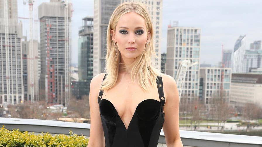 Top Talkers: Actress responds to critics who claimed it was sexist for Lawrence to pose on a rooftop in a black Versace dress next to fellow 'Red Sparrow' castmates who were in jackets and more layers.