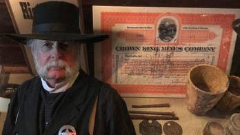 Arizona saloon has original artifacts from late 1800's, including bar, cowboy pistols, and mining equipment.