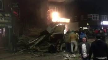Raw video shows building collapsed and on fire as police for the English city of Leicester say they are responding to a 'major incident.'