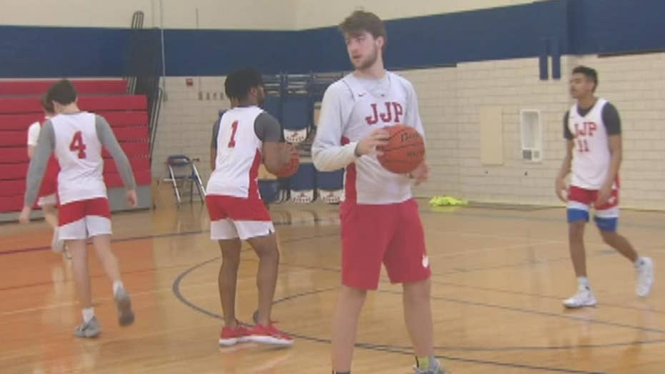 High school basketball team saves family from house fire