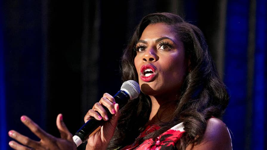 "In a revealing clip released by CBS, while talking on ""Big Brother: Celebrity Edition,"" Omarosa claims that she was shunned by White House officials because she is a black woman. She also spoke out about a potential tell-all book and what she really thinks of Trump's tweeting."