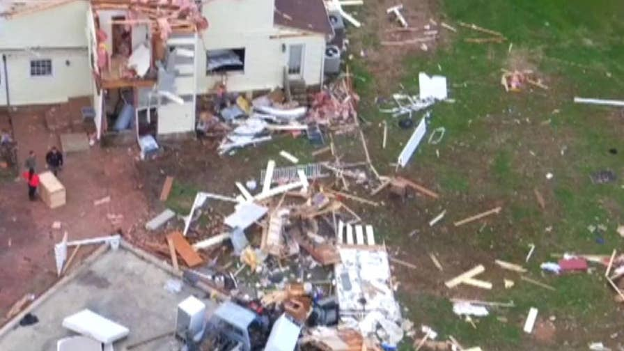 Homeowners are cleaning up after a series of tornadoes ripped through Kentucky and Tennessee; heavy rains pushed the Ohio River over its banks more than 20 feet above normal.