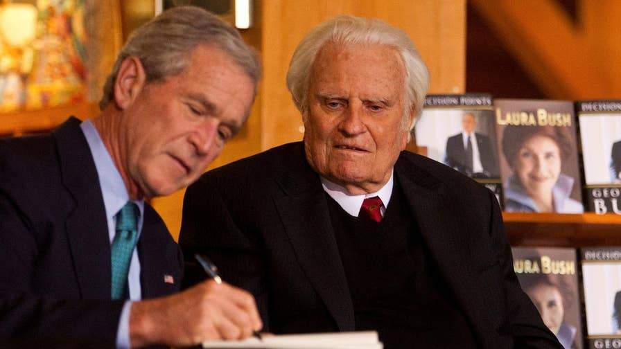 Former president attends public viewing for the late Rev. Billy Graham.