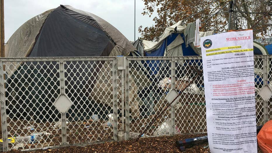 Orange County officials begin clearing massive homeless camp