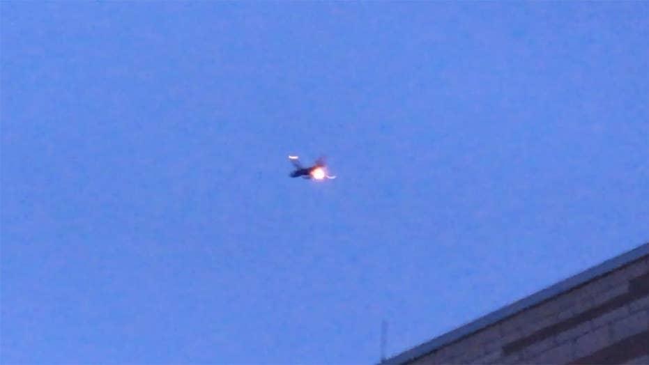 Southwest plane's engine burst into flames midair