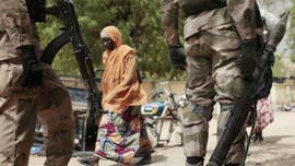 A lone Nigerian schoolgirl remains in Boko Haram captivity after the girl's mother said Thursday that she refused to convert to Islam.
