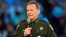 Some parents of the victims of the deadly Marjory Stoneman Douglas High School shooting have called for an investigation into Broward Sheriff's Officer Scot Peterson, who handled an assault case that involved Sheriff Scott Israel's son.