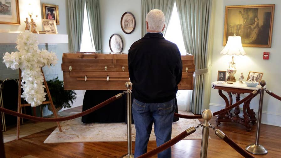 Former president Bush paid his respects to 'America's Pastor.'