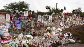 Two Marjory Stoneman Douglas students were arrested for knives, another student made online threats and a Broward County sheriff's deputy was suspended Tuesday at the Parkland, Florida, high school where 17 people were killed just over a month ago.