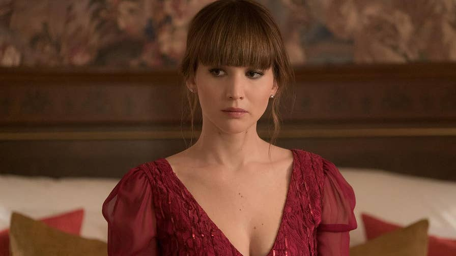 Lawrence says relationships with director Francis Lawrence and the crew helped her get through the challenging nude scene in the dark thriller 'Red Sparrow' about a ballerina forced to become a Russian spy.