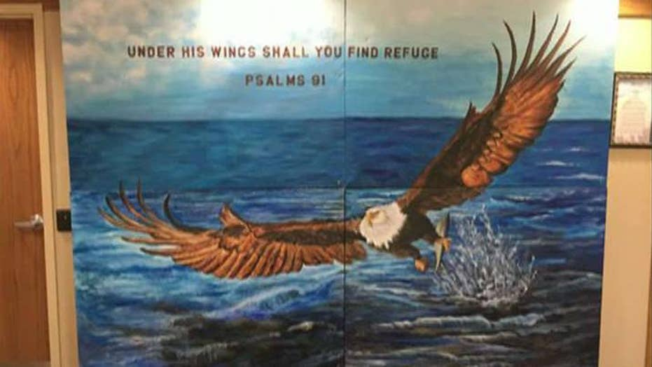 Atheists want Bible verse mural scrubbed