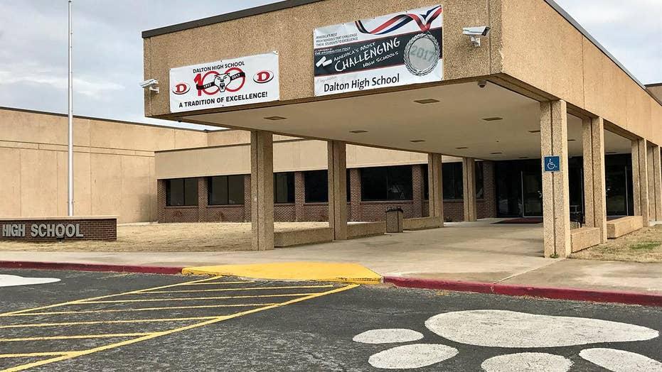 Teacher allegedly fires gun in classroom, taken into custody