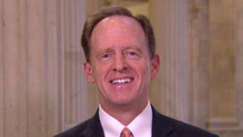 The Toomey-Manchin bill expands background checks. Sen. Toomey says the NRA is wrong in opposing broadening background checks to all commercial sales.