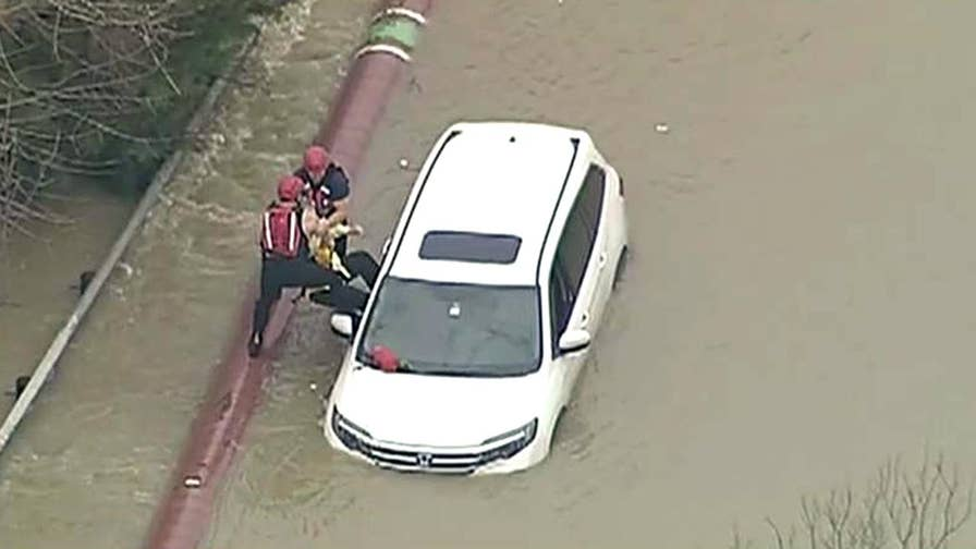Driver calls 911 after getting caught in flash flood after night of rain in Texas.