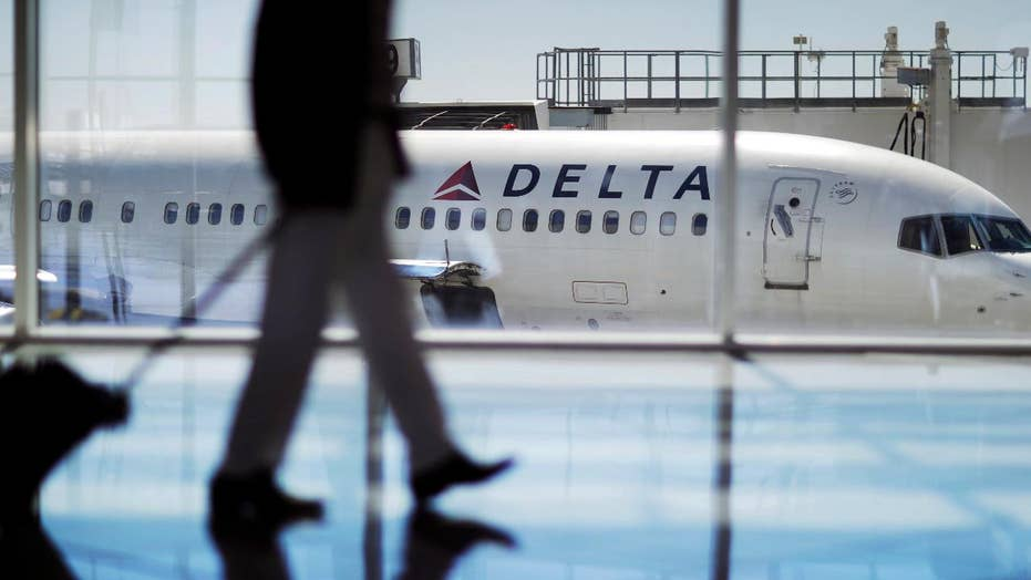Georgia lawmakers yank tax break for Delta over NRA stance