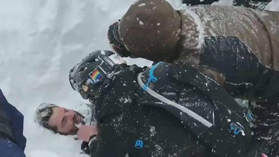 Snowboarder rescued from avalanche in California