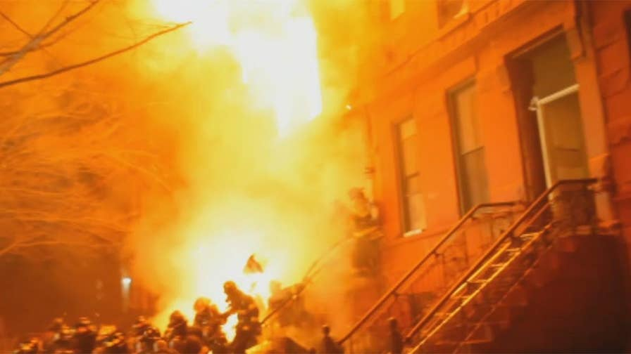 Raw video: Part of brownstone building collapses on group of firefighters while battling intense fire in Brooklyn, New York.