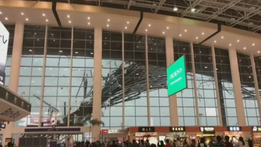 Incredible video shows gale-force winds destroying the roof of an airport in east China