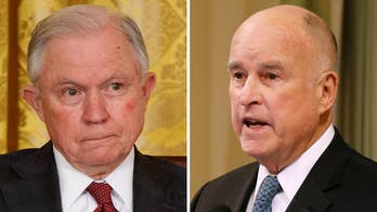 Governor Jerry Brown calls the Department of Justice lawsuit 'a political stunt' that will not work in California; Claudia Cowan reports from Sacramento.