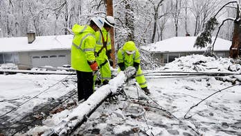 Powerful winter storm brings heavy snow, downs power lines across the Northeast corridor.