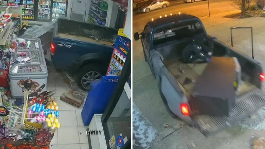 Raw video: D.C. police release surveillance footage showing suspects smash their way into convenience store with truck before driving away with ATM machine.