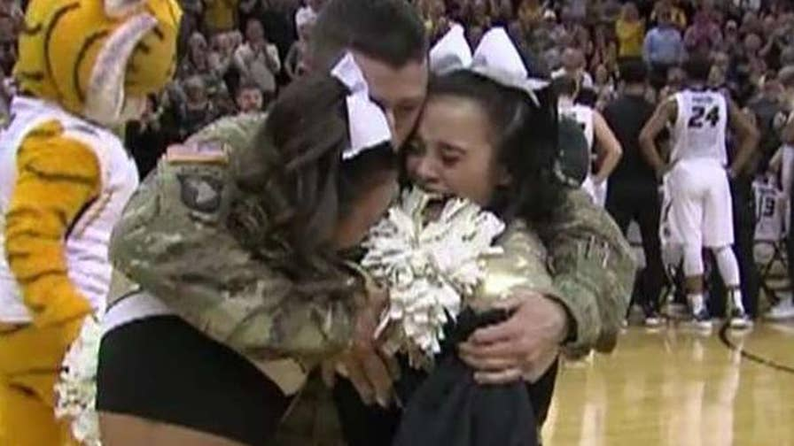 Soldier dad reunited with his daughters after 10 months overseas.