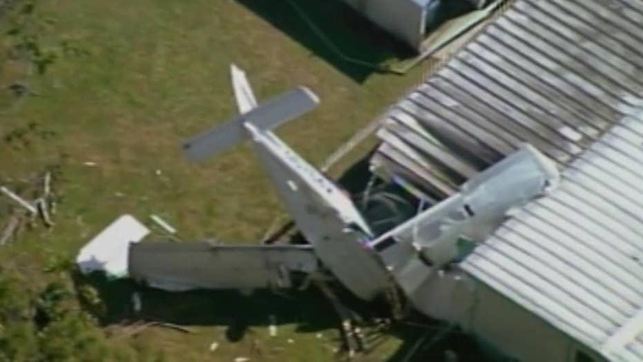 Plane crashes through trees into Florida home