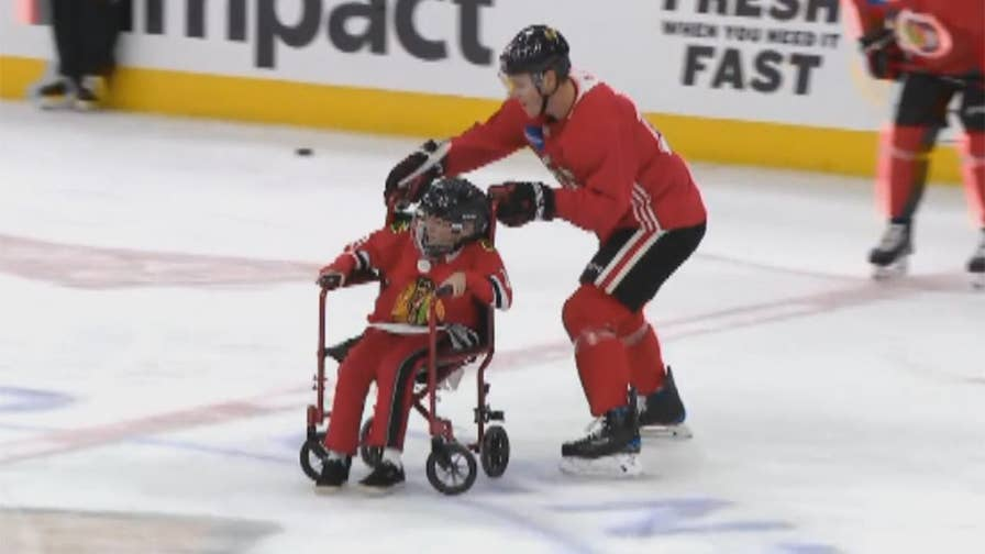 Raw video: 12-year-old Mason Berg, who suffers from muscular dystrophy, takes the ice with NHL's Chicago Blackhawks.