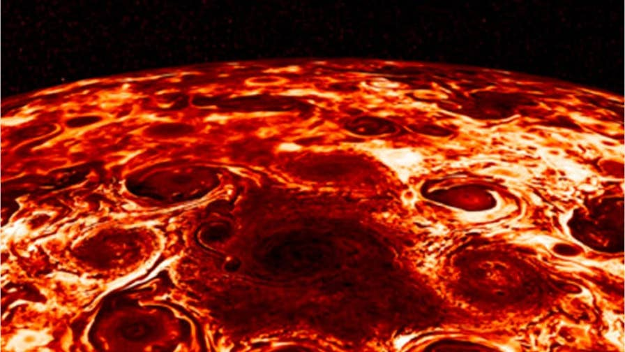 NASA's Juno probe captured images of Jupiter that show wind-sculpted bands that are nearly 1,900 miles and massive cyclones that surround the planet's north and south poles.
