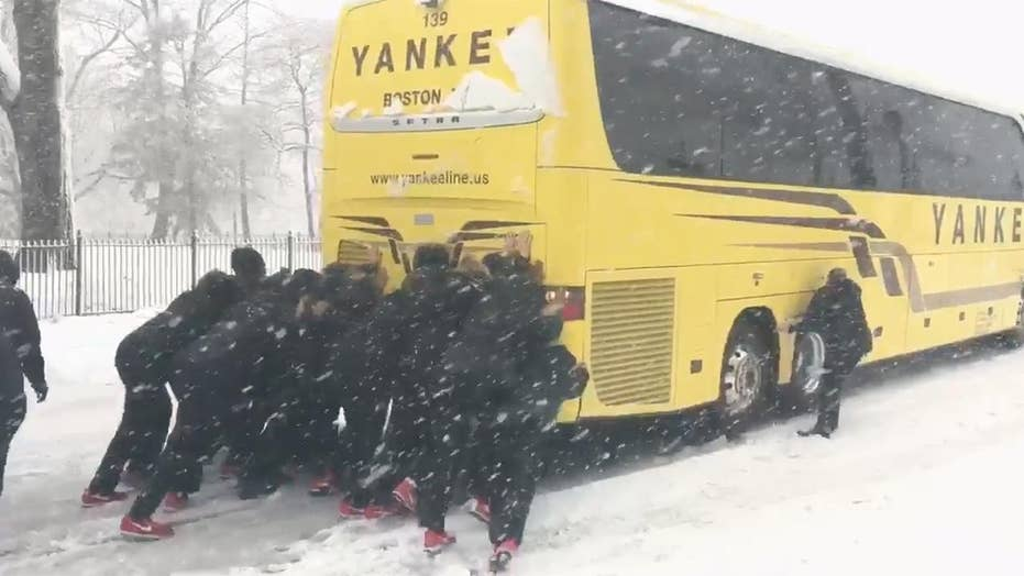 Northeastern women's basketball team pushes bus out of snow