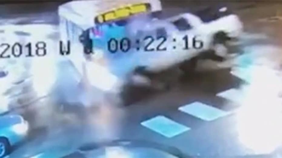 Bus smashes into SUV in dramatic crash caught on camera