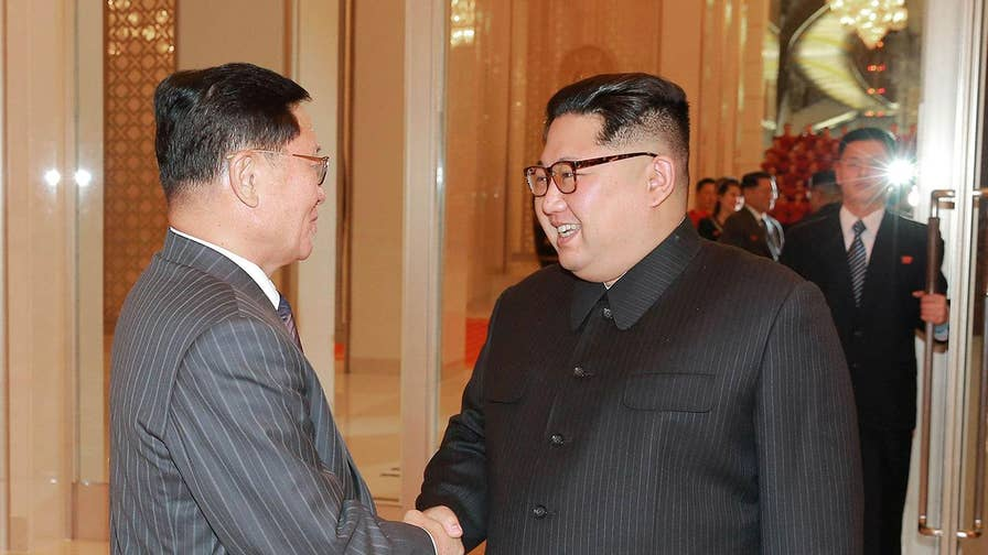 kim jon ii seeking to expand nuclear The two leaders smiled and shook hands after which kim jong-un gestured to moon they cross over to north korea briefly, which they did for a few steps, then returned to the south, holding hands.