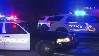 Suspect is believed to have shot two police officers, killing one, during an hours-long standoff.