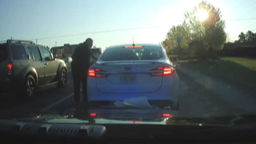 A driver fled a traffic stop with a Marietta, Georgia, police officer inside his vehicle.