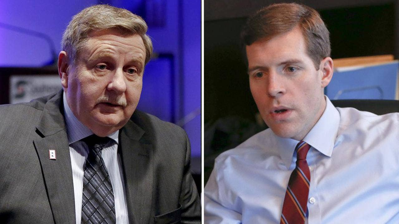 Democrat Conor Lamb narrowly led Republican Rick Saccone with most pre