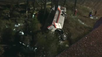 Raw video: Emergency crews respond to accident after charter bus carrying Texas students from Channelview High School reportedly returning from Disney World plunged into ravine in Alabama.