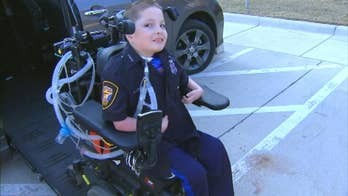 10-year-old boy in wheelchair becomes cop for a day