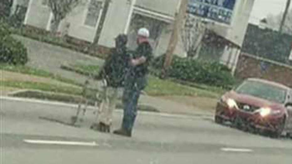 Driver stops to help elderly man cross the street