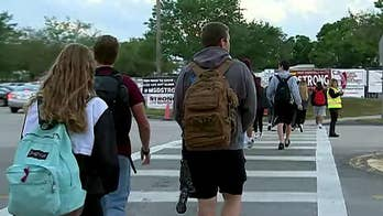 School walkouts mark one month since the mass shooting at Parkland high school. Phil Keating reports from Parkland, Florida.