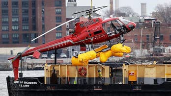 The family of one victim is suing the charter companies involved for 'negligence and carelessness' after a tourist helicopter went down in the icy waters of the East River, killing all five passengers on board.